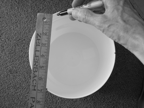 Measuring for the holes in the bucket