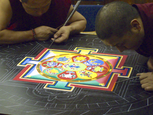 Buddhist monks creating mandala